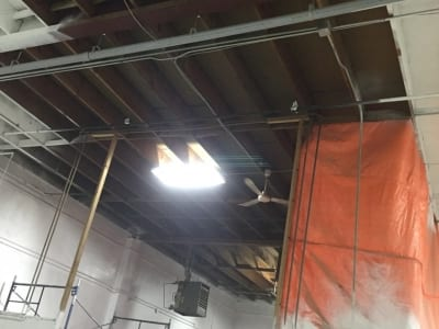 Interior ceiling of a garage being painted - beginning stages