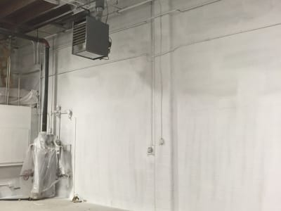 Interior of a garage being painted - first layer of paint