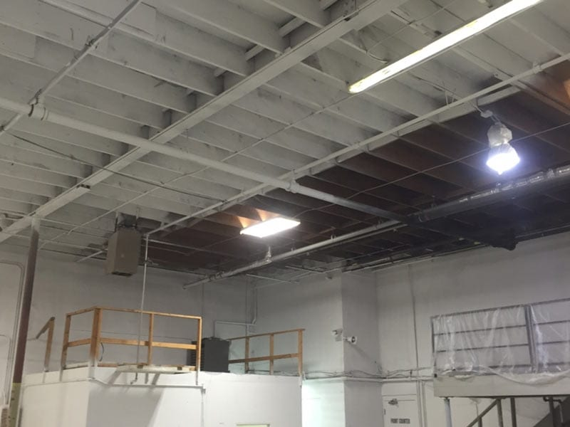 Interior ceiling of a garage being painted & in process