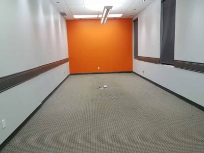 Recently painted narrow interior of an office space