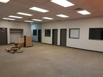 Recently painted interior of an office space with carpet area