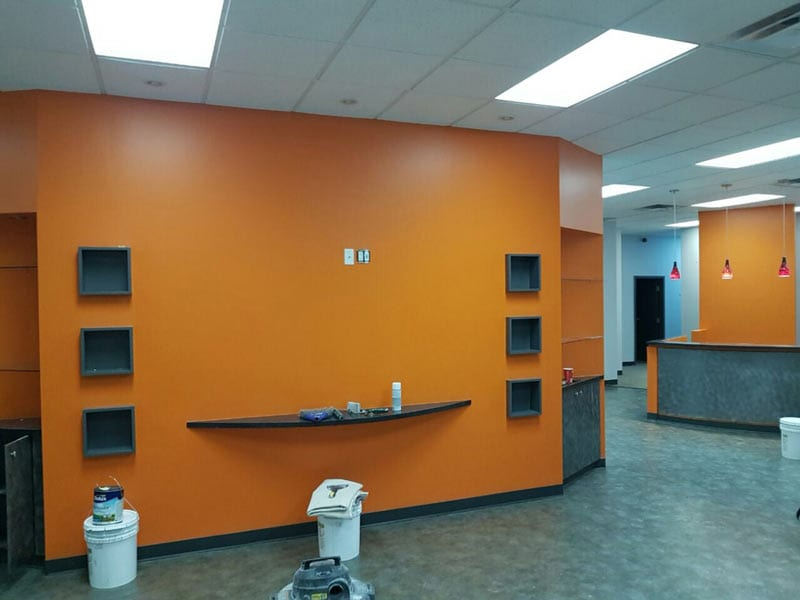 Recently painted interior of an office with painting supplies on floor