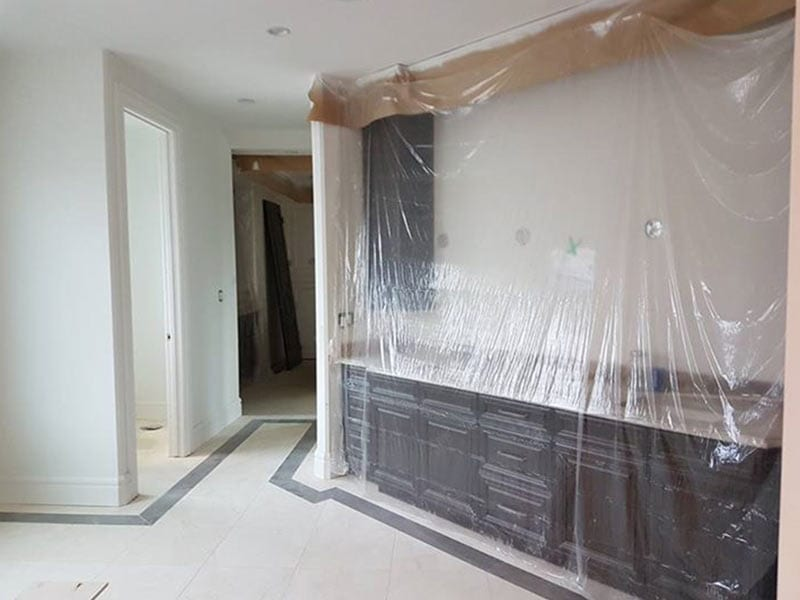 A home being prepared for painting with copious amounts of plastic film in Bathroom