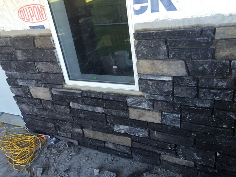 Close up of exterior brick facade being installed