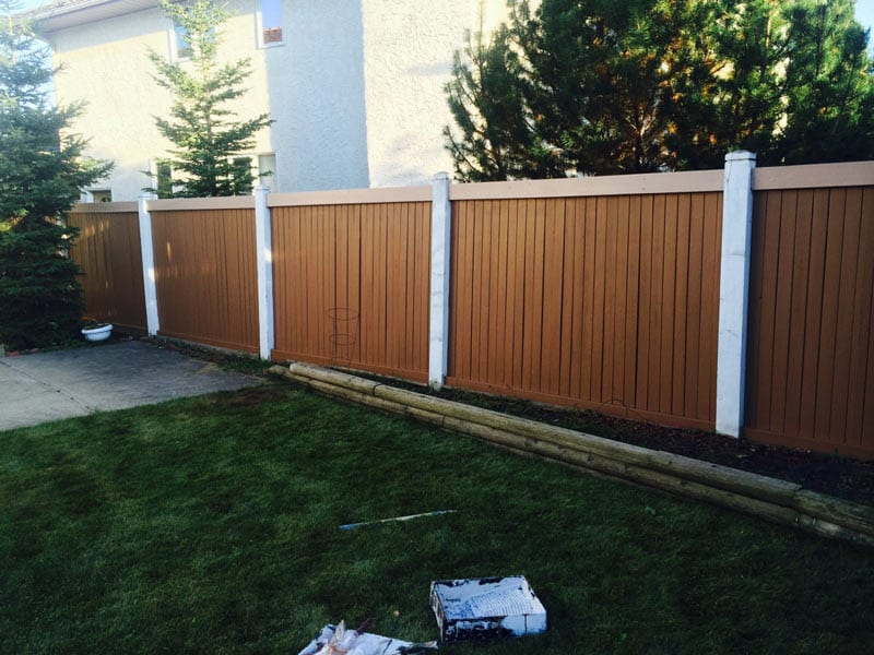 Exterior backyard fence under renovation