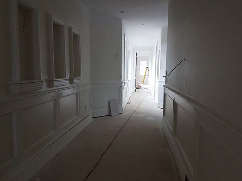 Second-story hallway of a large house being renovated
