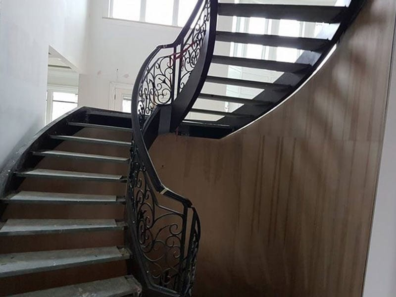 Close up of a mid-floor landing of a staircase being renovated