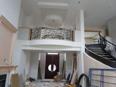 Two-story home interior balcony being renovated